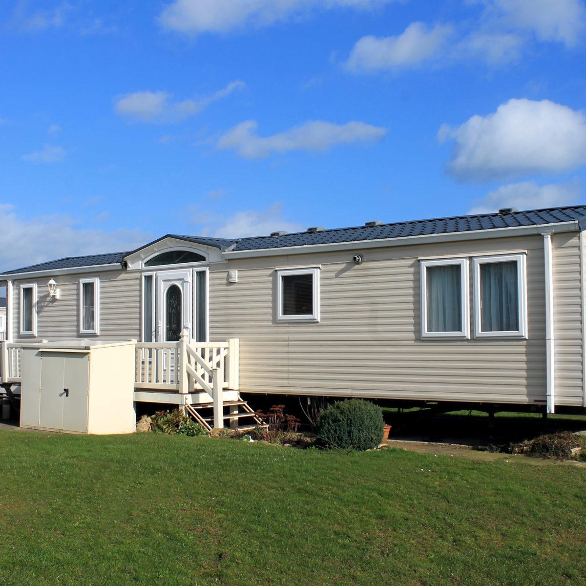 Cream caravan in trailer park